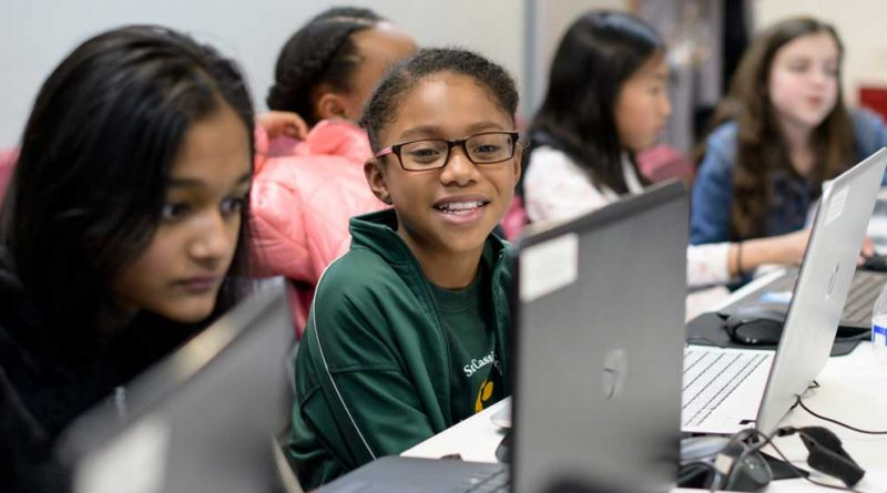 Girls learning computer coding